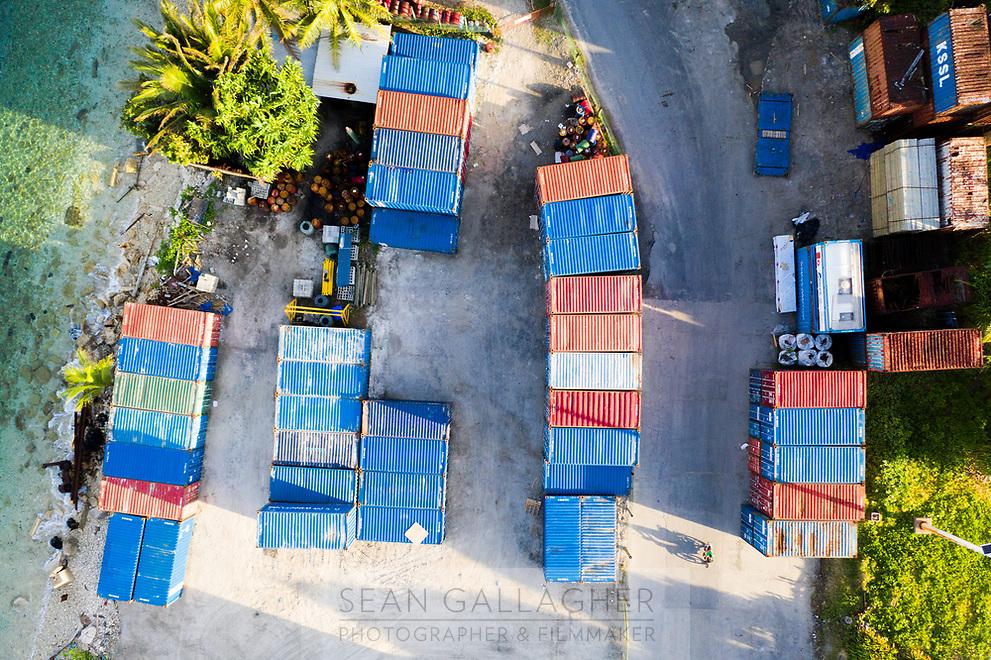 A motorbike (bottom-right) passes through Funafuti port. Funafuti, Tuvalu. March, 2019.