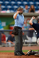 Umpire Tyler Jones calls a strike during a Southern League game between the Mobile BayBears and Pensacola Blue Wahoos on July 25, 2019 at Blue Wahoos Stadium in Pensacola, Florida.  Pensacola defeated Mobile 2-1 in the first game of a doubleheader.  (Mike Janes/Four Seam Images)