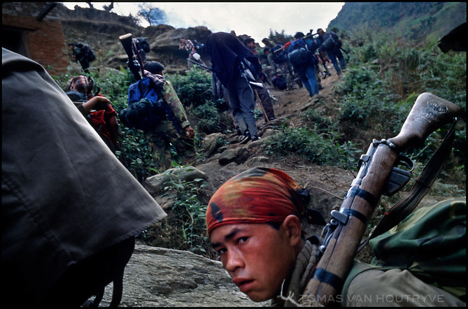 A column of Maoist rebel soldiers of the People's Liberation Army, treks up the trail to toward the village of Mahat, Nepal on Tuesday, 22 February 2005.<br />