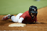 Yolbert Sanchez (29) of the Birmingham Barons dives back into first base during the game against the Mississippi Braves at Regions Field on August 3, 2021, in Birmingham, Alabama. (Brian Westerholt/Four Seam Images)