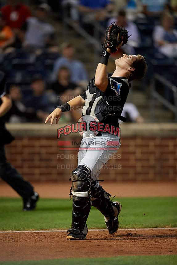 West Virginia Black Bears catcher Grant Koch (51) tracks a pop up during a game against the State College Spikes on August 30, 2018 at Medlar Field at Lubrano Park in State College, Pennsylvania.  West Virginia defeated State College 5-3.  (Mike Janes/Four Seam Images)