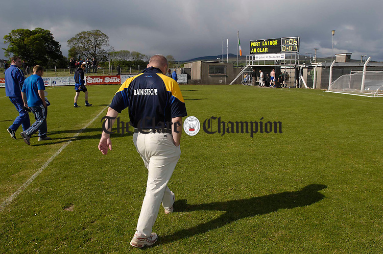 Clare manager Paidi O Se heads for the dressing room as the scoreboard tells it's own story after their senior championship game in Dungarvan. Photograph by John Kelly.