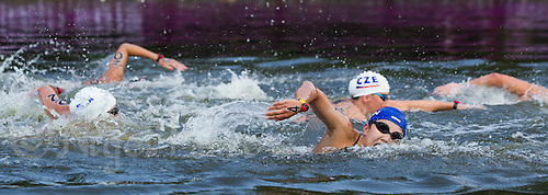 09 AUG 2012 - LONDON, GBR - Kida Yumi (JPN) (in blue swim hat) of Japan makes her way round the course during the women's 10km Marathon Swimming in Hyde Park, London, Great Britain during the London 2012 Olympic Games (PHOTO (C) 2012 NIGEL FARROW)