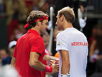 Switserland, Genève, September 20, 2015, Tennis,   Davis Cup, Switserland-Netherlands, Roger Federer (SUI)takes the deciding point against Thiemo de Bakker (NED) (R) and is congratulated<br /> Photo: Tennisimages/Henk Koster