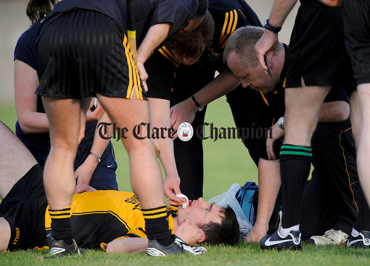 Clonlara's Paul Collins gets treatment for an injury during their championship game against Crusheen at Clarecastle. Photograph by John Kelly.