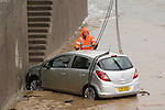 281111 Vauxhall Corsa ends up in the sea in Mumbles