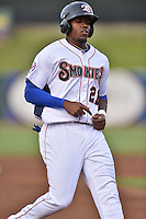 Tennessee Smokies right fielder Jorge Soler #21 runs to third during a game against the Jacksonville Suns at Smokies Park July 10, 2014 in Kodak, Tennessee. The Suns defeated the Smokies 6-5. (Tony Farlow/Four Seam Images)