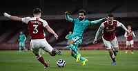 April 3rd 2021; Emriates Stadium, London, England;  Liverpools Mohamed Salah challenges Arsenals Kieran Tierney during the Premier League match between Arsenal and Liverpool at the Emirates Stadium in London