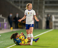 ORLANDO, FL - JANUARY 18: Samantha Mewis #3 of the USWNT questions the call on a foul as she stands over Gisela Robledo #10 of Colombia during a game between Colombia and USWNT at Exploria Stadium on January 18, 2021 in Orlando, Florida.