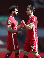 24th April 2021; Anfield, Liverpool, Merseyside, England; English Premier League Football, Liverpool versus Newcastle United; Mohammed Salah of Liverpool shakes hands with team mate Diogo Jota prior to the kick off