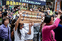 Hong Kong, 1 April 2012..Pro-democracy demonstration of thousands against the government's voting policy in Hong Kong since Leung Chun-ying, 57, was elected as Hong Kong's new chief executive on March 25 by a 1,200-strong pro-Beijing election committee... .Photo Kees Metselaar