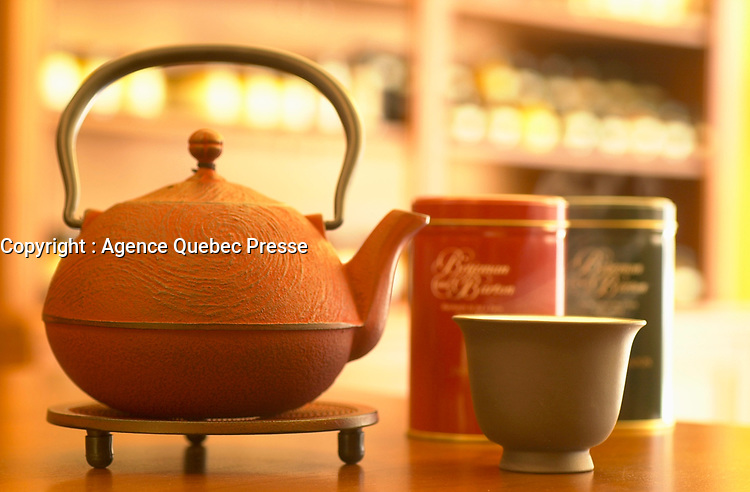 July 2002, Montreal, Quebec, Canada<br /> <br /> A traditional Chinse Tea Pot and cup,<br />  in a Montreal Tea store.