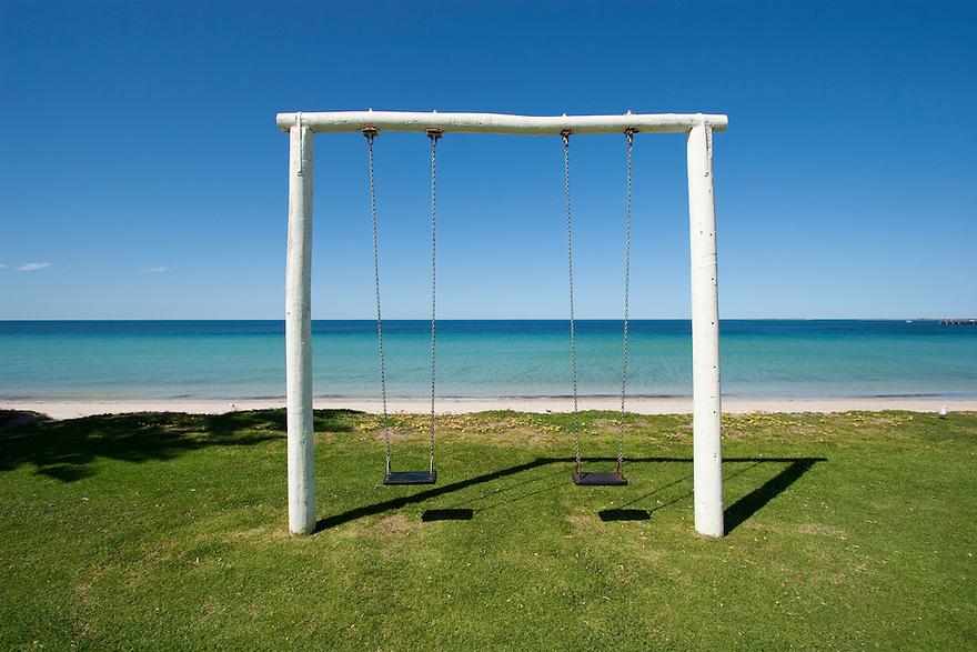 Swing by the seaside
