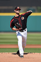 Rochester Red Wings pitcher Kris Johnson (11) throws a warmup pitch during the first game of a doubleheader against the Buffalo Bisons on July 6, 2014 at Frontier Field in Rochester, New  York.  Rochester defeated Buffalo 6-1.  (Mike Janes/Four Seam Images)
