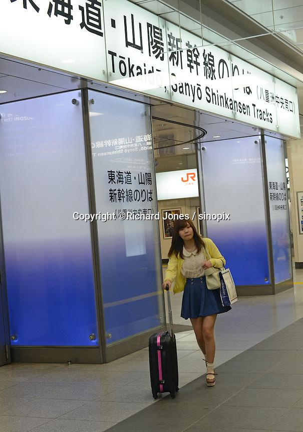 Passengers walk through the Tokaido and Sanyo Shinkansen entrance at Tokyo Station.