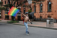 BOGOTA, COLOMBIA - JUL 04: A man skates during a LGBTIQ pride parade on July 04, 2021 in Bogota, Colombia. The parade is a protest against violence suffered by the LGBTIQ community in Colombia. (Photo by Leonardo Munoz/VIEWpress)