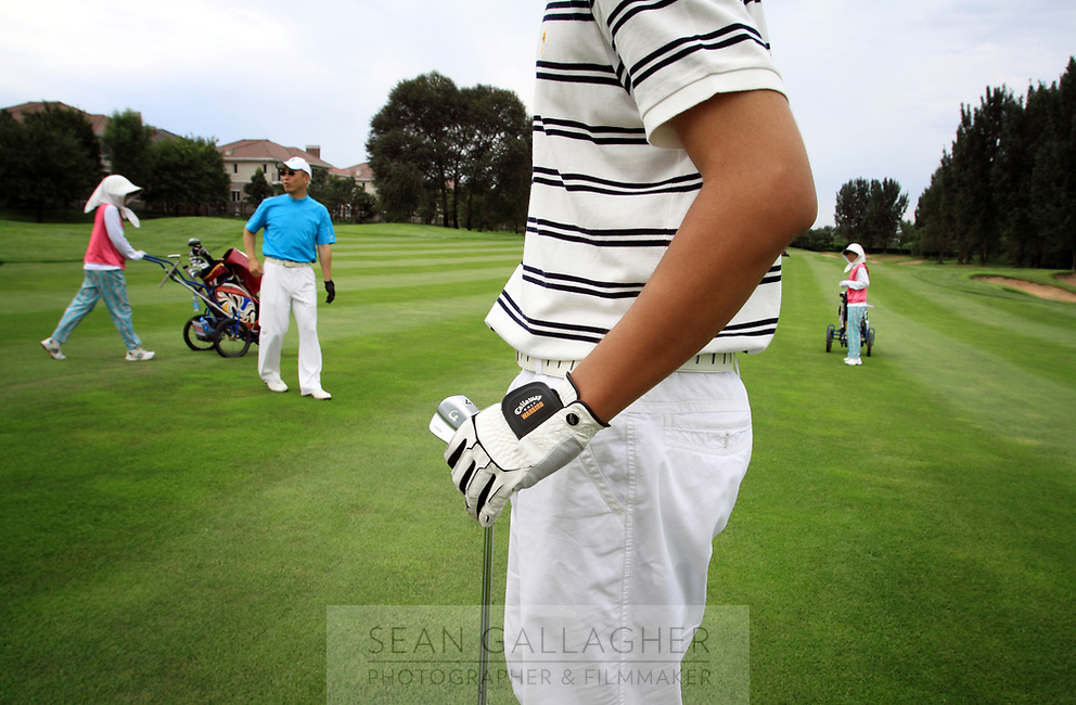 CHINA. Golfers at the Huatang International Golf Club in Beijing. 2009
