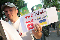 A scalper attempts to sell two tickets for the second round FIFA World Cup match in Cologne, Germany on Monday, June 26th 2006  between Ukraine and Switzerland. Although Germany World Cup officials had warred before the games that they would be checking the ID's of every ticket, the idea was abandoned. Scalping outside stadiums has been widespread for most games.
