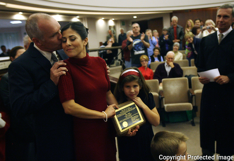 Newly sworn in Escondido, California city council member Olga Diaz is kissed by her husband immediatley after Diaz was sworn in to office at Escondido City Hall December 3, 2008.  photo for North County Times