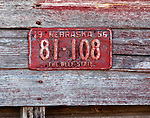 Red Vintage License Plate on Barn Nebraska