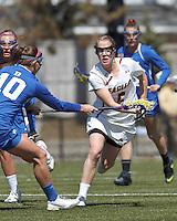 Duke University defender Lauren Martin (10) stick checks Boston College midfielder Sarah Mannelly (6)Boston College (white) defeated Duke University (blue), 10-9, on the Newton Campus Lacrosse Field at Boston College, on April 6, 2013.