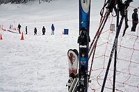 """Beginning skiers ride the """"magic carpet"""" lift on the bunny hill at Showdown Ski Area on King's Hill in the Little Belt Mountains near Neihart, Montana, USA."""
