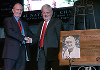 Arkansas Democrat-Gazette/MICHAEL WOODS<br /><br />Former University of Arkansas track and field coach John Mc Donnell shakes hand with Dr. B Alan Sugg during Thursday evenings tribute to the Arkansas coach at the Tyson indoor Track in Fayetteville.<br /><br />09/18/08