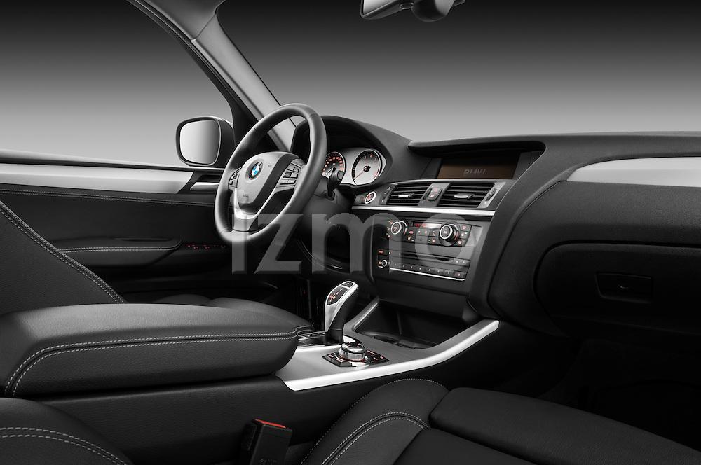 Passenger side dashboard view of a 2011 BMW x3 xDrive35i SUV