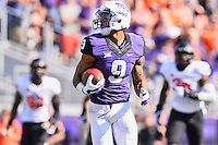 TCU wide receiver Josh Doctson (9) looks back at Oklahoma State defenders on his way to score a touchdown during first half of an NCAA football game, Saturday, October 18, 2014 in Fort Worth, Tex. TCU defeated Oklahoma State 42-9. (Mo Khursheed/TFV Media via AP Images)