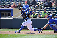 Omaha Storm Chasers third baseman Cheslor Chuthbert (24) swings against the Round Rock Express at Werner Park on April 12, 2016 in Omaha, Nebraska.  The Express won 6-4.  (Dennis Hubbard/Four Seam Images)