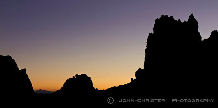 Sunset over Smith Rock, central Oregon; Silhouette; Mt. Jefferson in distance