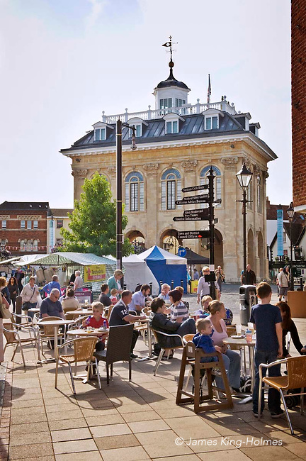 The Market Place at Abingdon-on-Thames, Oxfordshire (used to be Berkshire) looking west. The County Hall, now a museum, is on the left and market stalls on the right of the road was built in 1678 by Christopher Kempster, who is believed to have worked with Wren on St Paul's Cathedral in London. Abingdon was situated in the county of Berkshire, but under local government re-organisation in 1974 it was transferred to Oxfordshire.