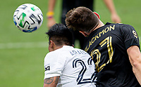 LOS ANGELES, CA - OCTOBER 25: Julian Araujo #22 of the Los Angeles Galaxy and Tristan Blackmon #27 of LAFC go head to head during a game between Los Angeles Galaxy and Los Angeles FC at Banc of California Stadium on October 25, 2020 in Los Angeles, California.