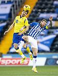 Kilmarnock v St Johnstone…30.01.21   Rugby Park   SPFL<br />Craig Bryson outjumps Alan Power<br />Picture by Graeme Hart.<br />Copyright Perthshire Picture Agency<br />Tel: 01738 623350  Mobile: 07990 594431