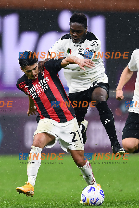Brahim Diaz of Ac Milan and Emanuel Gyasi of Spezia compete for the ball during the Serie A football match between AC Milan and Spezia Calcio at San Siro Stadium in Milano  (Italy), October 4th, 2020. Photo Image Sport / Insidefoto