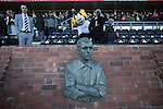 Derby County 1 Nottingham Forest 2, 17/01/2015. iPro Stadium, Championship. Sammie the mascot and home supporters in the main stand pictured behind a statue of former player Steve Bloomer at the iPro Stadium before Derby Country's Championship match against Nottingham Forest. The match was won by the visitors by 2 goals to 1, watched by a derby-day crowd of 32,705. The stadium, opened in 1997, was formerly known as Pride Park. Photo by Colin McPherson.