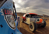 Dec. 11, 2011; Chandler, AZ, USA; Onboard view from the truck of LOORRS pro two unlimited driver Robby Woods as Adrian Cenni attempts to pass on the inside during the Lucas Oil Challenge Cup at Firebird International Raceway. Mandatory Credit: Mark J. Rebilas-