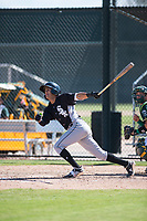 Chicago White Sox infielder Kelvin Maldonado (10) follows through on his swing during an Instructional League game against the Oakland Athletics at Lew Wolff Training Complex on October 5, 2018 in Mesa, Arizona. (Zachary Lucy/Four Seam Images)