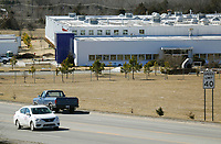 Traffic passes by the former Hanna's Candle Building Monday, February 22, 2021, located 3655 S. School Avenue in Fayetteville. Plans are in the works to turn the former site of Hanna's Candle into a 99,000-square-foot warehouse with a nearly 40,000-square-foot office and showroom. Check out nwaonline.com/210223Daily/ and nwadg.com/photos for a photo gallery.<br /> (NWA Democrat-Gazette/David Gottschalk)