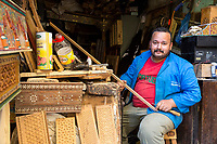 Fes, Morocco.  Woodcarver in his Workshop in the Medina.