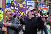 To Delay Is To Betray.  Brexit supporters demonstrate outside the Houses of Parliament as MPs vote on amendments to Theresa May's withdrawal deal with the EU.  Westminster, London.