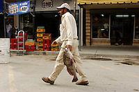 Man with fish; Progreso, Mexico; 211pm, 7Dec2005