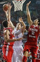 Kosta PEROVIC (Serbia) shoots over Hidayet TURKOGLU (Turkey) and Kerem GONLUM (Turkey) during the semi-final World championship basketball match against Turkey in Istanbul, Serbia-Turkey, Turkey on Saturday, Sep. 11, 2010. (Novak Djurovic/Starsportphoto.com) .