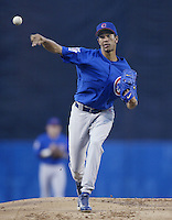 Juan Cruz of the Chicago Cubs pitches during a 2002 MLB season game against the Los Angeles Dodgers at Dodger Stadium, in Los Angeles, California. (Larry Goren/Four Seam Images)