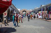 Essaouira, Morocco.  Young Women Wearing Blue Jeans, Slacks, Scarves.  Street Scene, Avenue Mohammed Zerktouni.