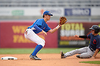Nolan Jones (22) of Holy Ghost Prep in Langhorne, Pennsylvania playing for the Chicago Cubs scout team waits for a throw as Cory Wood (right) slides in safely on a stolen base during the East Coast Pro Showcase on July 29, 2015 at George M. Steinbrenner Field in Tampa, Florida.  (Mike Janes/Four Seam Images)