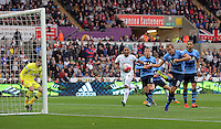 Harry Kane of Tottenham Hotspur (R) scores an own goal during the Barclays Premier League match between Swansea City and Tottenham Hotspur played at The Liberty Stadium, Swansea on October 4th 2015