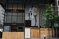 NEW YORK, NEW YORK - JUNE 2: A Coach store is boarded up after a night of looting on stores due to protest on June 2, 2020 in New York City. Protests spread across the country in at least 30 cities across the United States, over the death of unarmed black man George Floyd at the hands of a police officer, this is the latest death in a series of police deaths of black Americans. New York face it's second night of a curfew (Photo by Joana Toro / VIEWpress via Getty Images)