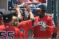 Kennys Vargas (35) of the New Britain Rock Cats is congratulated by his teammates in the dugout during a game against the Altoona Curve at New Britain Stadium on July 23, 2014 in New Britain, Connecticut.  Altoona defeated New Britain 8-5. (Gregory Vasil/Four Seam Images)