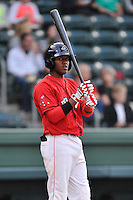 Shortstop Luis Alejandro Basabe (5) of the Greenville Drive bats in a game against the Columbia Fireflies on Friday, April 22, 2016, at Fluor Field at the West End in Greenville, South Carolina. Columbia won, 5-3. (Tom Priddy/Four Seam Images)